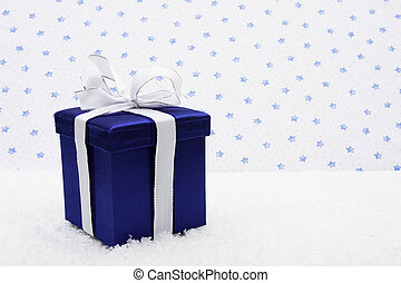 Holiday Present - Blue present wrapped with white bow on ...