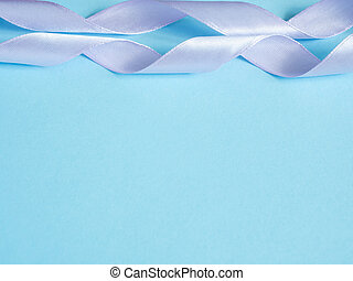 Holiday ribbon on blue background with copy space