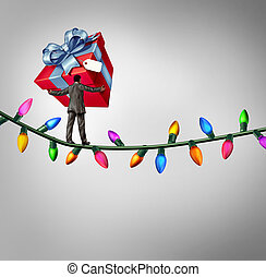 Holiday risk concept as a person holding a giant gift on a high wire tightrope made from christmas lights as a debt and credit metaphor and symbol of the challenges of giving.
