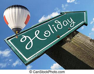 HOLIDAY road sign