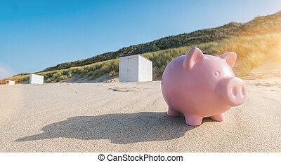 Holiday savings piggy bank on a beach