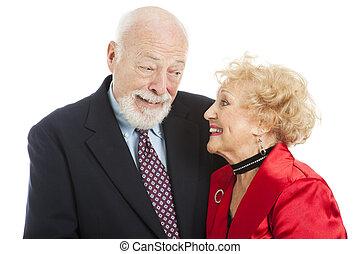 Holiday Seniors - Knowing Look - Beautiful senior couple...