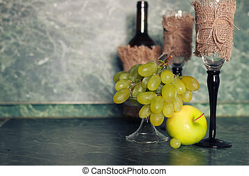 holiday set wine bottle with green grape on background