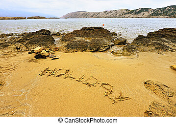 Holiday sign on the beach sand