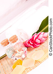 Holiday spa concept with pink ginger flower and soaps