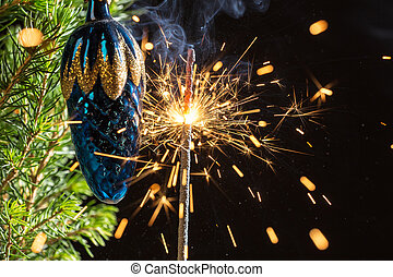 sparks and spruce branches
