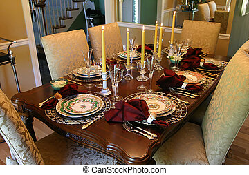 Holiday Table - a table set with fine china and candles for...