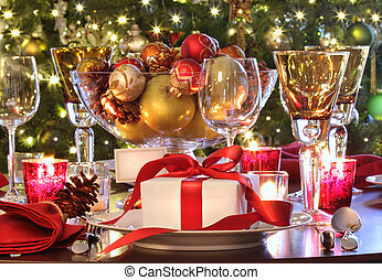 Holiday table setting with red ribboned gift - Elegant...