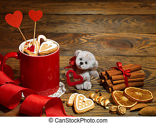 Holiday teddy bears hugging by Christmas decorations by antique rustic wooden background
