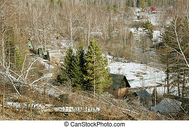 Holiday village in a valley in the woods