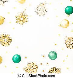 Holiday winter frame with Christmas balls, wooden snowflake decorations on white background. Flat lay, top view