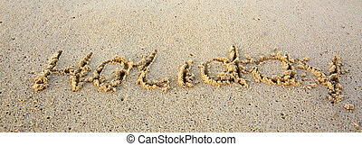 Holiday Written in sand at the beach.