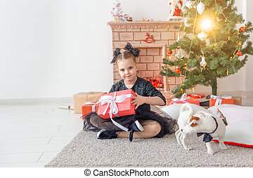Holidays and childhood concept - Portrait of little happy cute girl with Christmas present