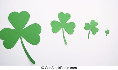 green paper shamrock on white background - holidays and st...