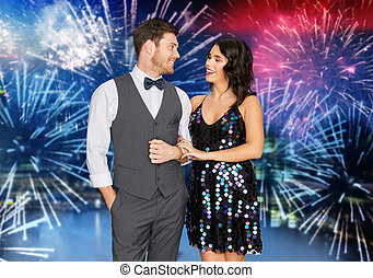 happy couple at party over firework background