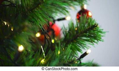 hand decorating christmas tree with ball - holidays,...