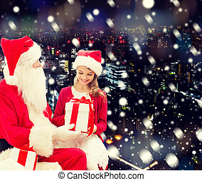 smiling little girl with santa claus and gifts - holidays, ...
