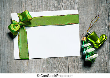 Holidays gift card with green bow