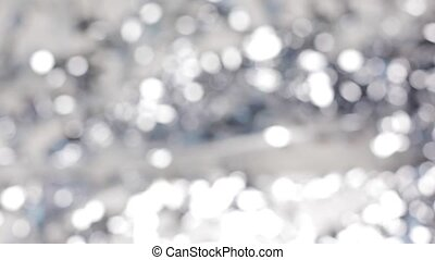 blurred silver christmas lights bokeh - holidays, luxury and...