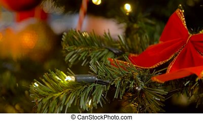 artificial christmas tree decorated with red bow - holidays...
