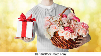 man holding basket full of flowers and gift box - holidays, ...
