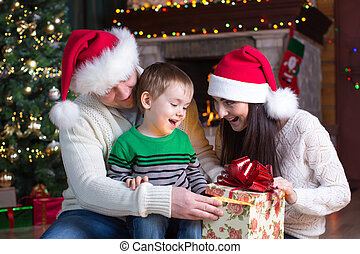 holidays, presents, christmas concept - happy mother, father and child boy with gift box