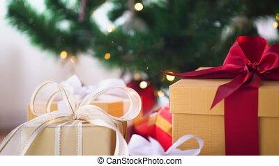 gift boxes at christmas tree - holidays, presents, new year...