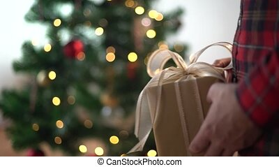 hands giving and receiving christmas gift box - holidays,...