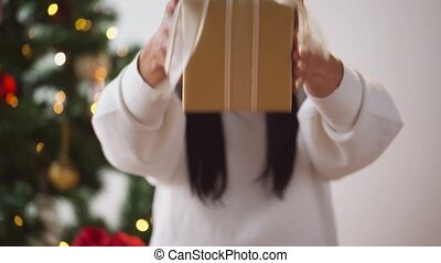 woman holding christmas gift box