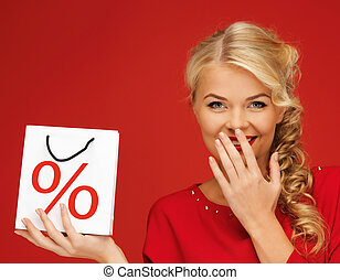 woman holding bag with percent sign