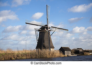 Holland windmill. Old mill chalk and flour . The beautiful backdrop of the countryside of Holland.