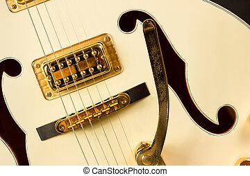 Extreme closeup of an electric hollow body guitar