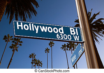 Hollywood Boulevard with sign illustration on palm trees -...
