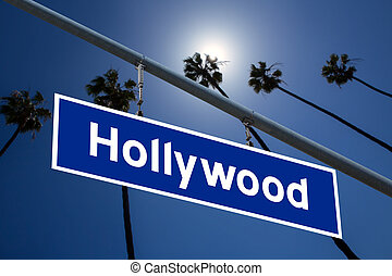 Hollywood California road sign on redlight with pam trees ...
