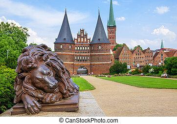 Holstentor. Lubeck, Germany - Lion statue beside Holstein...