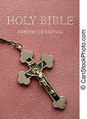 Holy Bible and crucifix. - Crucifix lying on cover of closed...