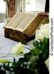 Holy Bible and Flowers on altar in the church - Basilica of...