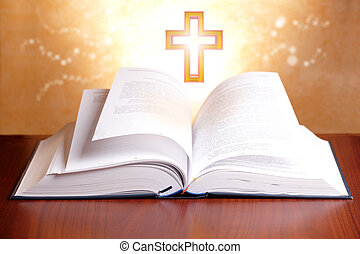 Holy bible - Open holy bible with peaceful light and cross