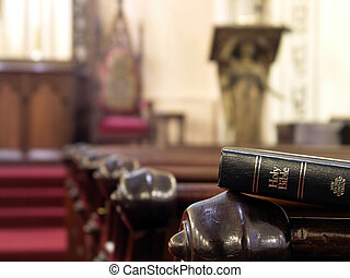 Holy Bible - Bible resting on the back of a church pew....