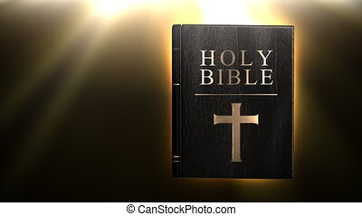 Holy bible with glowing rays in bac