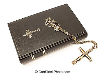 Holy bible with silver cross isolated on white background