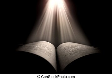 Old book illuminated by a beam of light