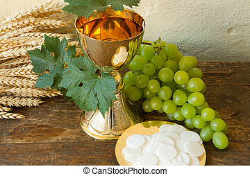 Holy bread and wine - Holy communion image showing a golden...