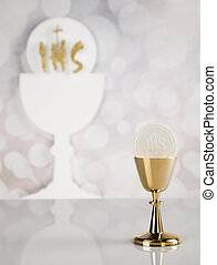 Holy communion a golden chalice, composition isolated on white