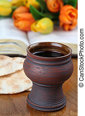 Holy communion - Chalice with red wine, pita bread, Holy...