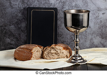 holy communion chalice with wine and bread