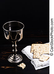 holy communion chalice with wine, bread and Bible. Lord's supper