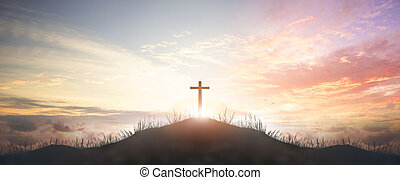 Holy concept: Silhouette cross on  mountain sunset background