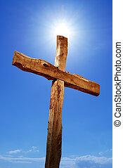 Holy cross against blue sky