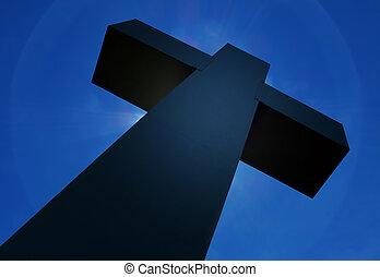 Holy cross against dark blue sky